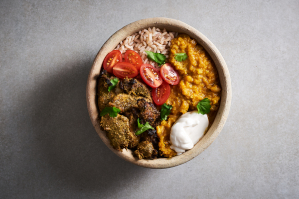 Atcha food bowl on a grey surface