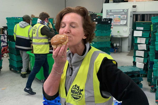 City Harvest volunteer enjoying a doughnut