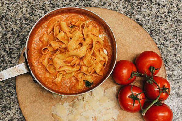 Pasta in a tomato sauce in a saucepan