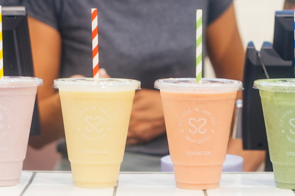Shakes lined up next to each other on a counter