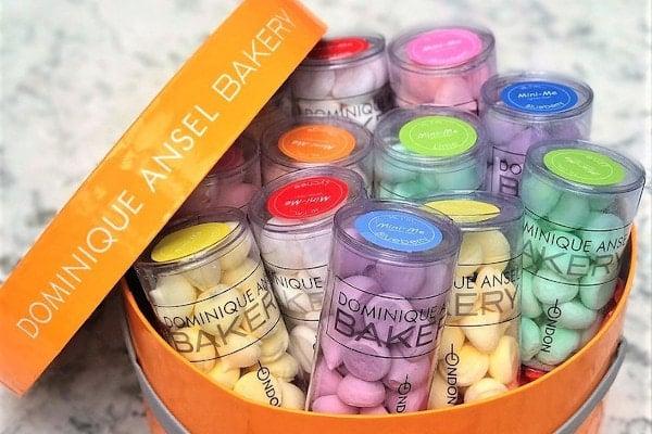 Orange box full of brightly coloured mini meringues