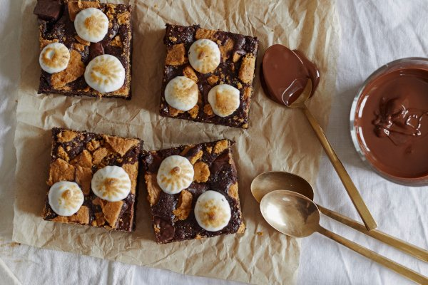 Four smores flavoured brownies on greaseproof paper