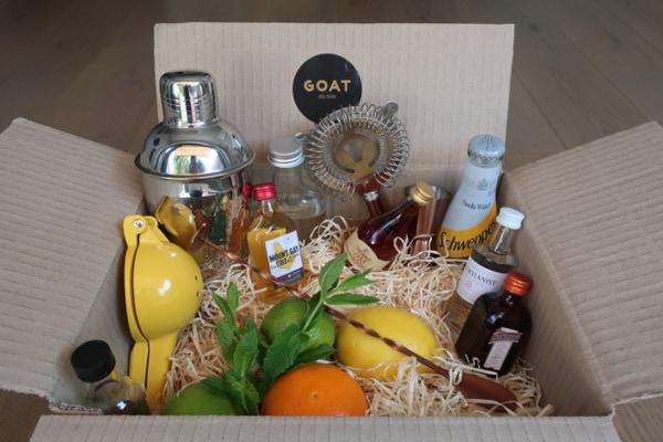 cardboard box full of cocktail making ingredients as tools