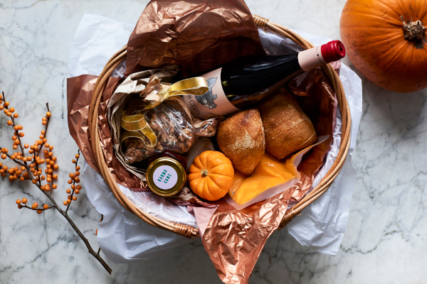 Baske with pumpkins, granola, and ready made soup