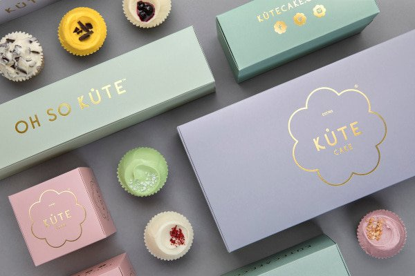 Pastel coloured boxes and cupcakes