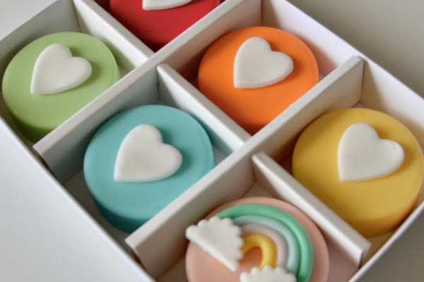 Sweet treats decorated in bright colours with hearts