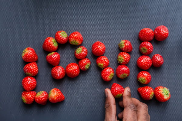 Strawberries spelling out the word 'Love'