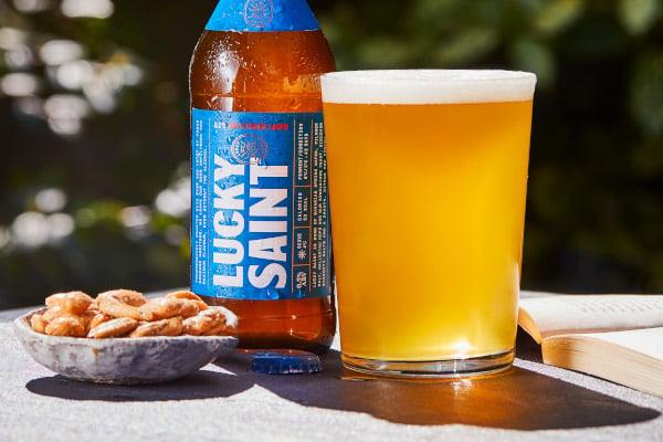Lucky saint bottle next to pint glass