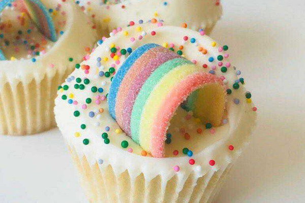 Cupcakes with rainbow candy and sprinkles on top