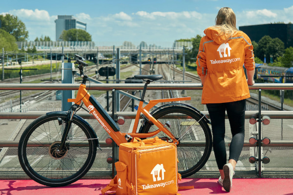 Orange Takeaway.com e-bike and rider