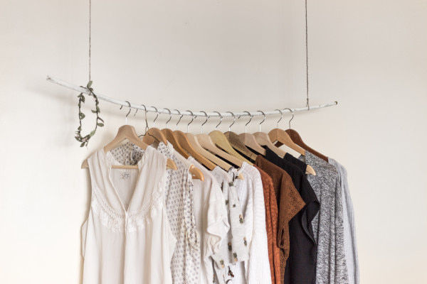 Hanging rail with neutral coloured clothes on