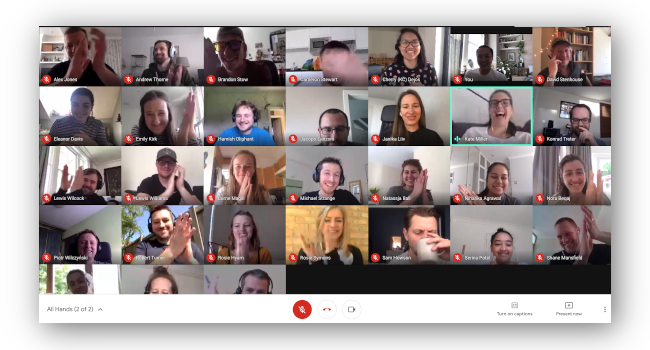 Company-wide video call, everyone is clapping on camera