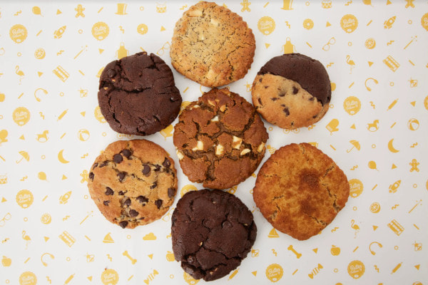 seven cookies on sheet of paper