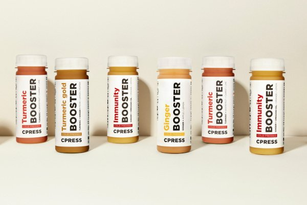 booster bottles lined up against cream background