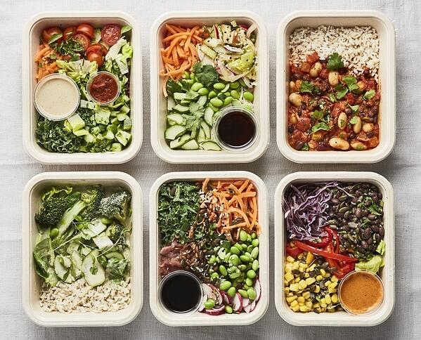 Six healthy ready meals next to each other
