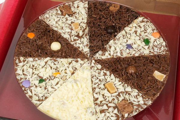 Chocolate shaped like a pizza, divided into slices