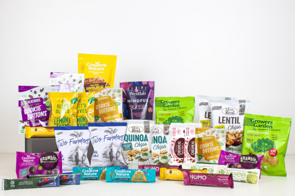 lots of snack bars and packets against a white background