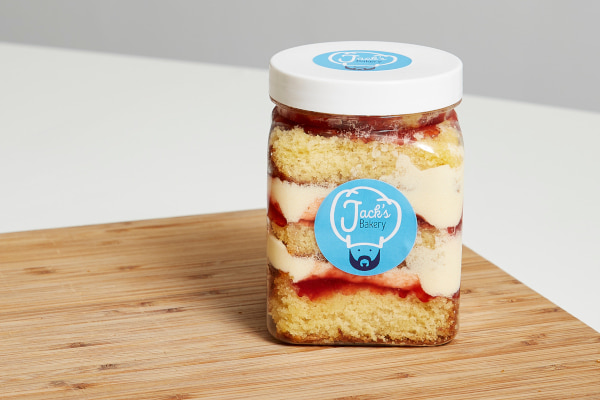 Cake in a jar on top of wooden board