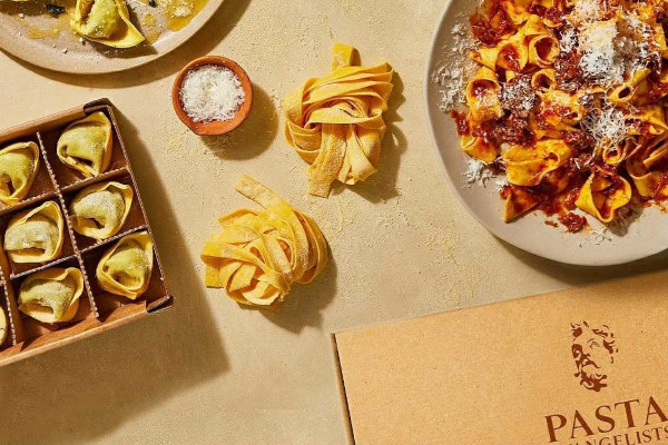 fresh pasta in boxes and on a plate