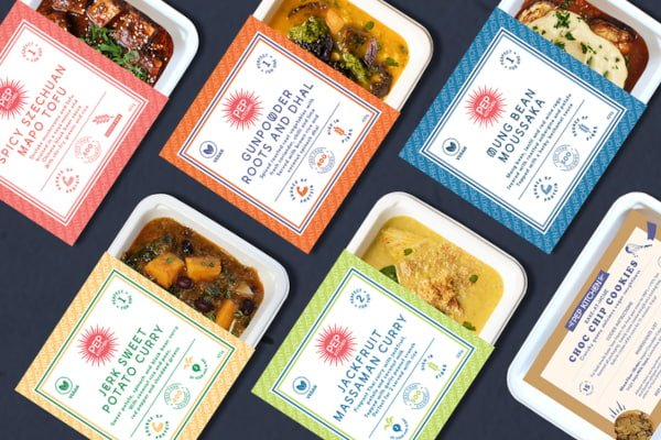 Line up of colourfully packaged ready meals
