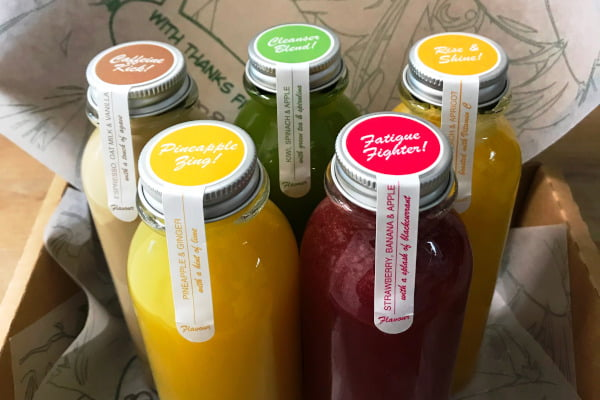 five bottles of colourful juices