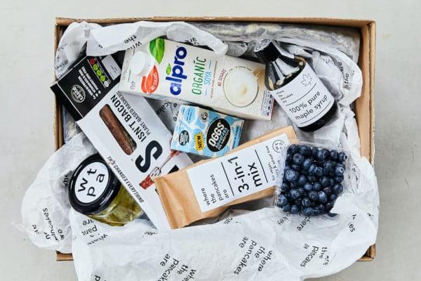 Box full of vegan pancake ingredients and toppings